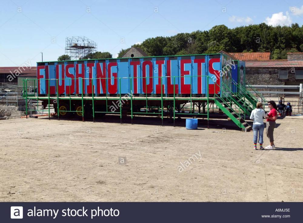 the-flushing-toilets-at-glastonbury-festival-the-biggest-music-festival-A6MJ5E.thumb.jpg.87a23392ee5d1b761015a536d2e1c973.jpg